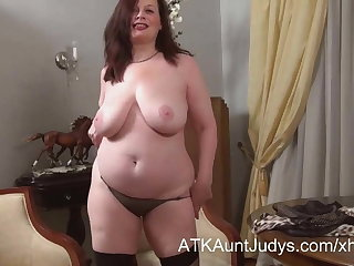 Nina strips and teases like a good Russian MILF.