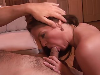 Busty MILF maons while she gets fucked from the back