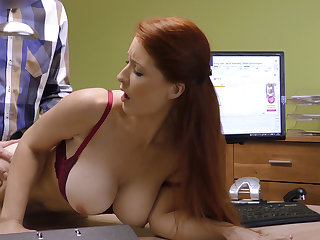 Attractive boobs for credit manager. Redhead