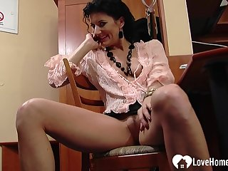 Office chick shows some skin while talking to the boss on the phone