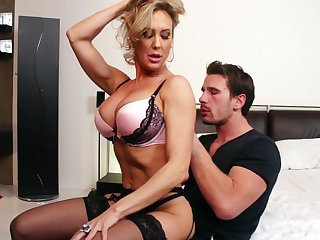 Brandi Love is ready for hard fuck from behind with a dude on the bed