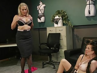 Premium matures in scenes of rough femdom at the office