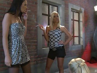 Three amazingly hot friends in stockings have fisting session outdoors