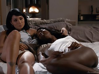 Naked lezzie beauties share their lust in strong interracial XXX