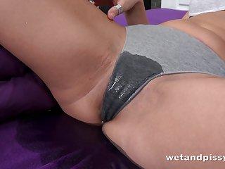 Naughty sexy Ellen Milion pisses in bed and starts masturbating right away
