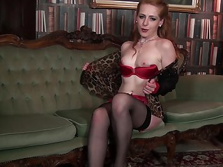 Naughty cougar Tia Jones drops her panties to finger her hairy pussy