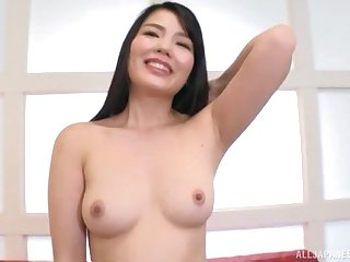 Shy Japanese babe takes off her clothes and fingers her wet pussy