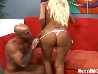 Stud picks up blond Rhyse Richards to penetrate her on crimson couch