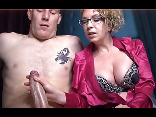 Domme T is a horny, platinum-blonde female in a satin tee-shirt who enjoys to all over voluptuous handjobs