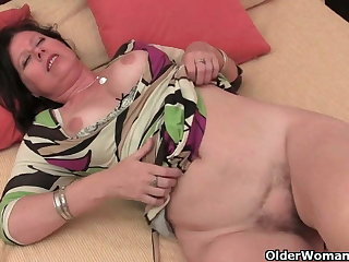Older woman with big tits gives her hairy cunt a treat