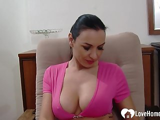 While her man is recording her, she will show off her feet and her tits